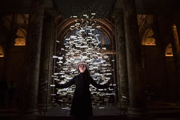 Es Devlin poses in front of her Christmas tree in the entrance to the V&A museum in London.