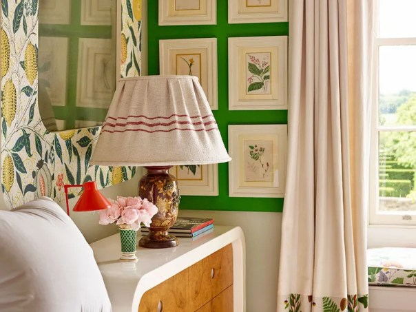 In a guest room, watercolor botanical prints are echoed in Josef Frank floral patterns.