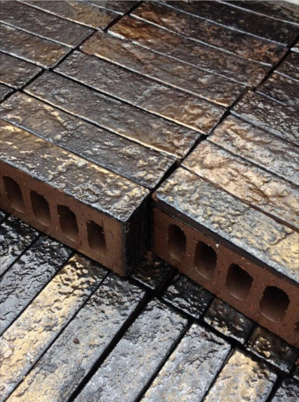 A close-up view of the gold-infused bricks.
