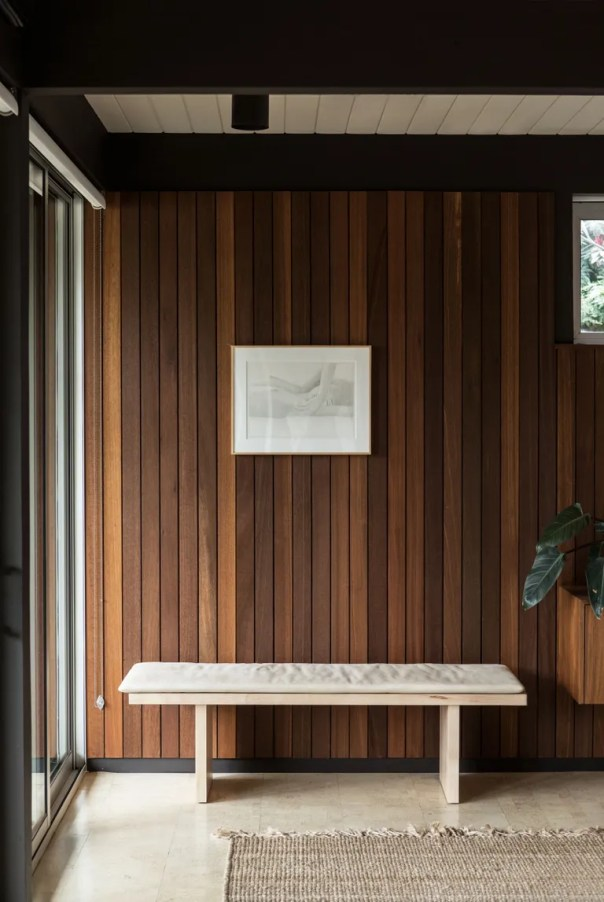 bench in front of paneled wall