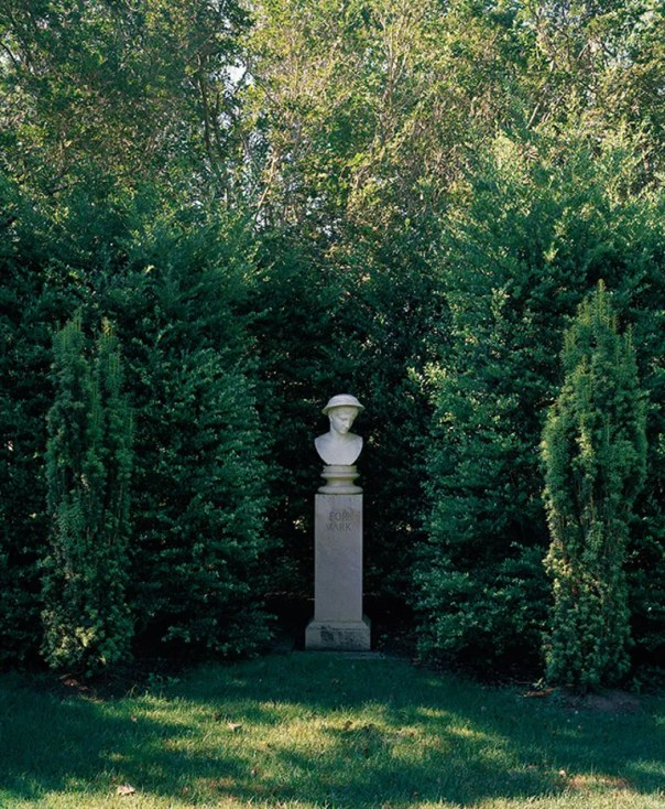 While many of Catherine Opie's photographs explore social and political themes, she is also known for her landscapes. Here, in an untitled piece from 2000, Opie captures a bust in a garden.