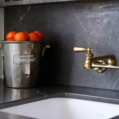 Brass Faucet Kitchen Cabinets Knobs How To Get An Antique For Way Less Architectural Digest With Matte Patina D And Black Marble Counter