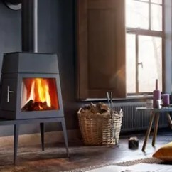 Images Of Living Rooms With Wood Burning Stoves French Country Style Room Decorating Ideas 6 Modern Takes On Architectural Digest Angular Black Metal Woodburning Stove Door And Rounded Shelf One Side