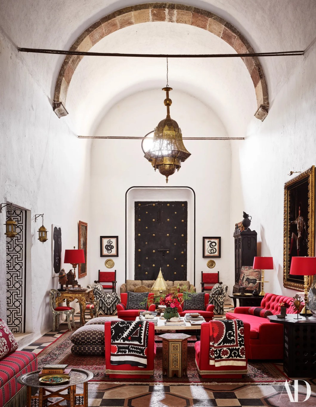 A Turkish lantern from Ceylon et Cie hangs over a living room decorated with vintage Billy Baldwin slipper chairs and...