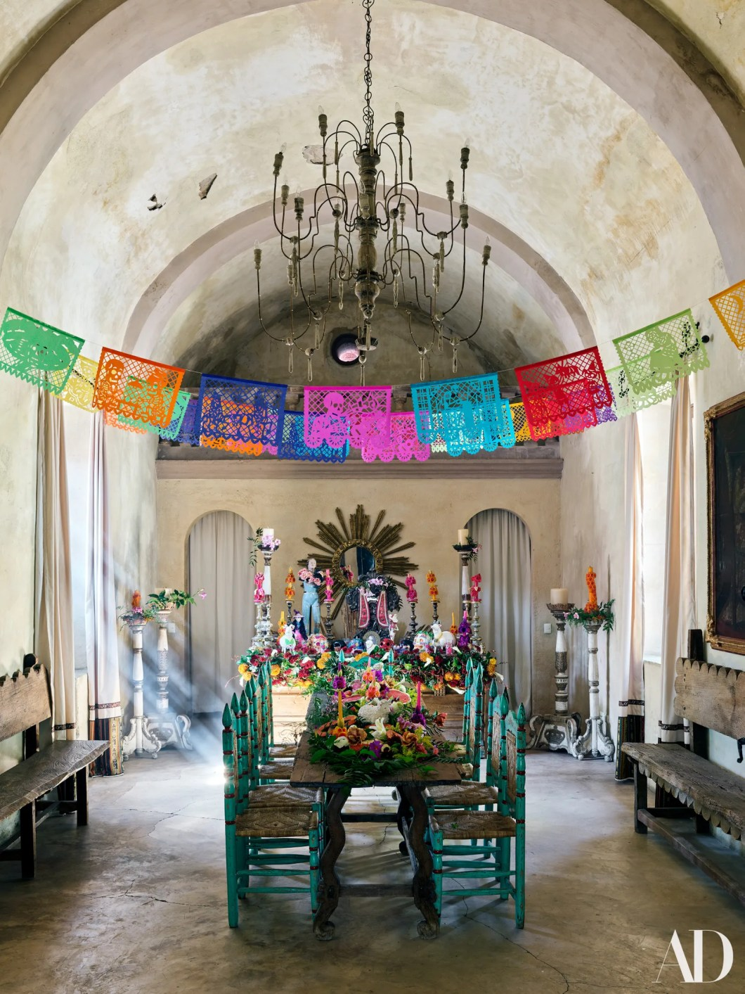 In the chapel vintage Mexican chairs line up at an 18thcentury Spanish colonial table.