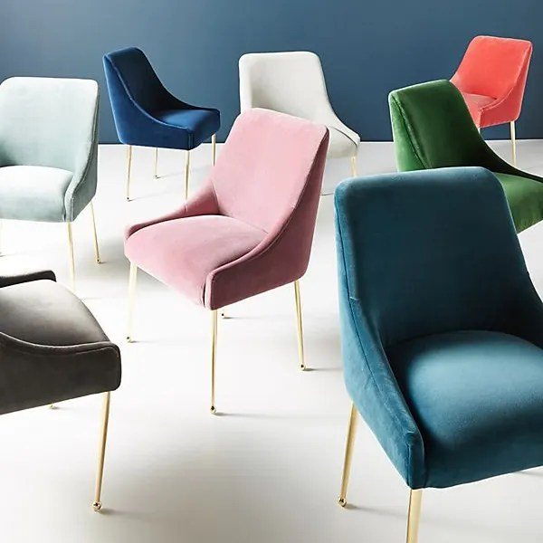 accent chairs in various colors of velvet with gold legs