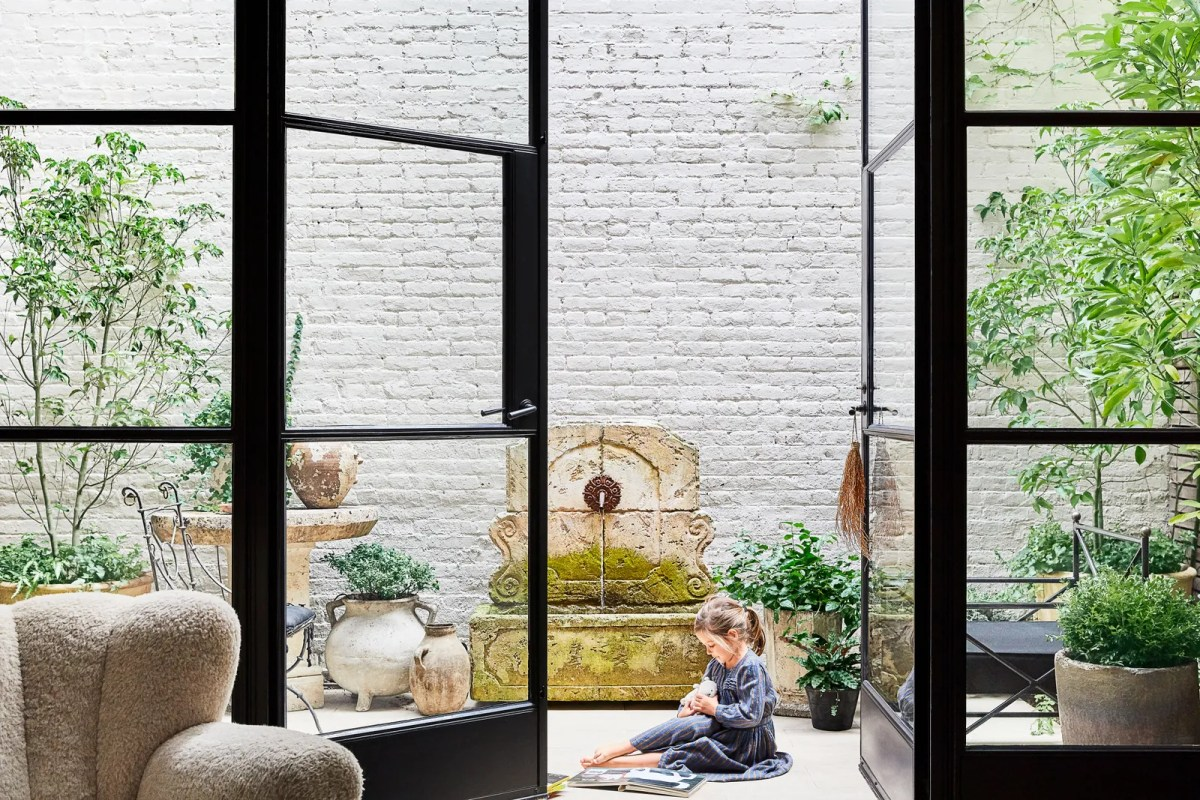 Poppy plays in the courtyard which features a 17thcentury French fountain and an 18thcentury stone table.