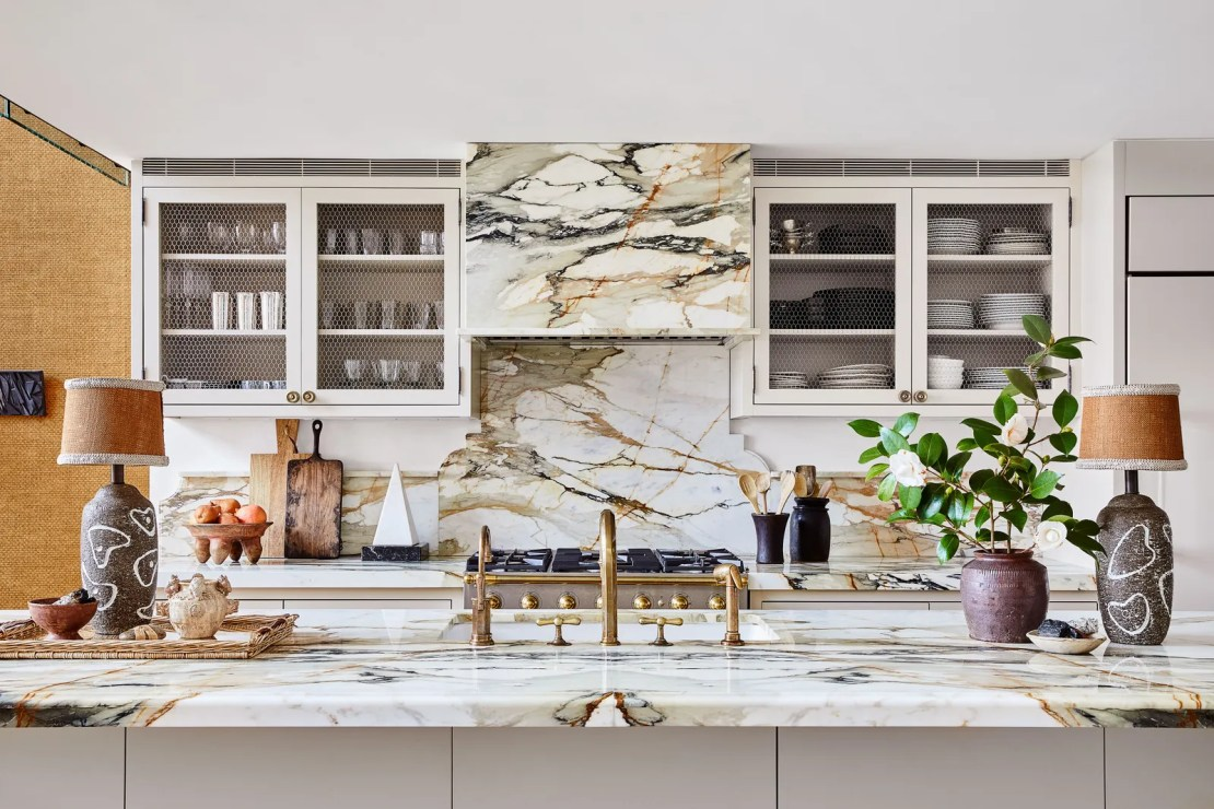 In the kitchen the custom hood backsplash and countertops are made of Calacatta.