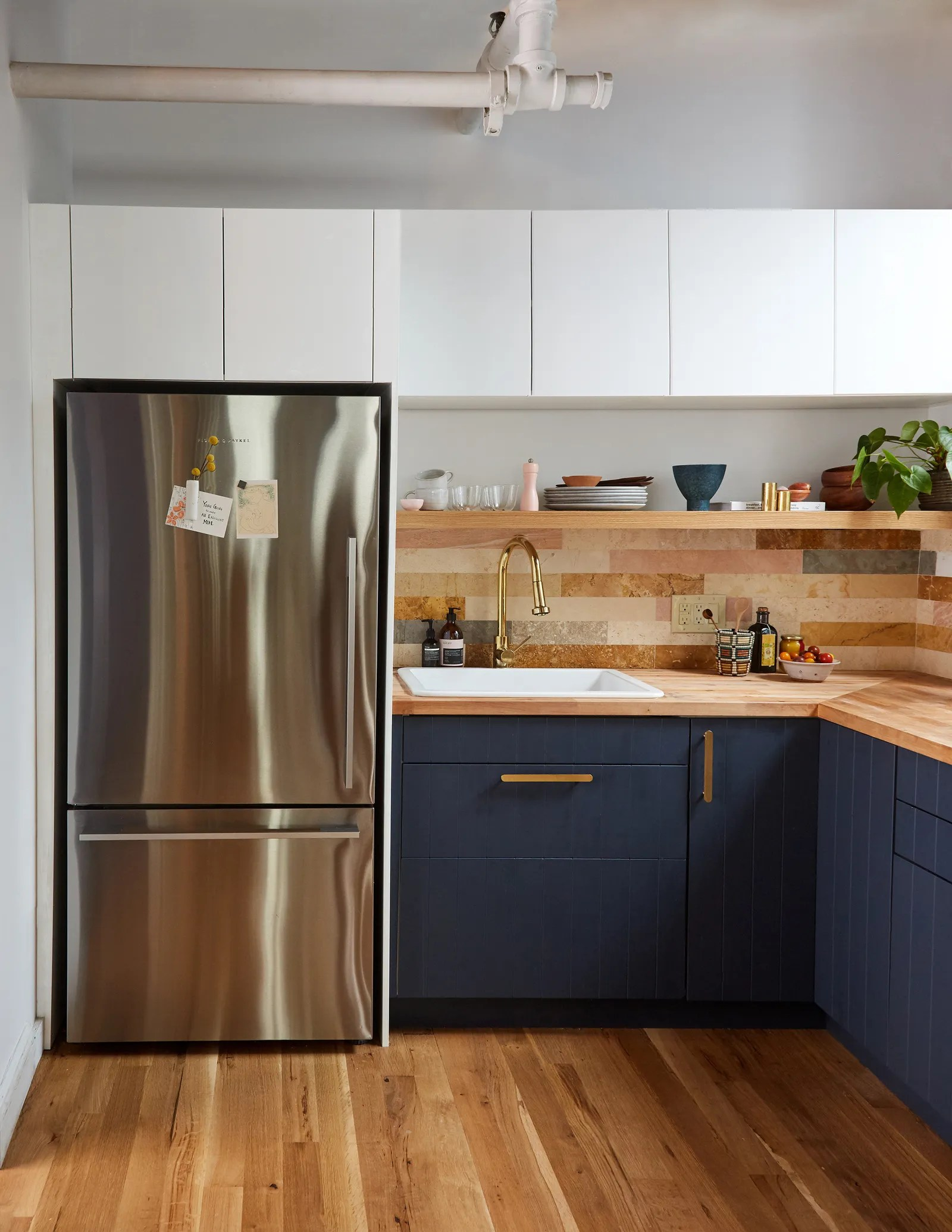 You Ll Love The Mix Of High And Low In This Small Kitchen Remodel Architectural Digest