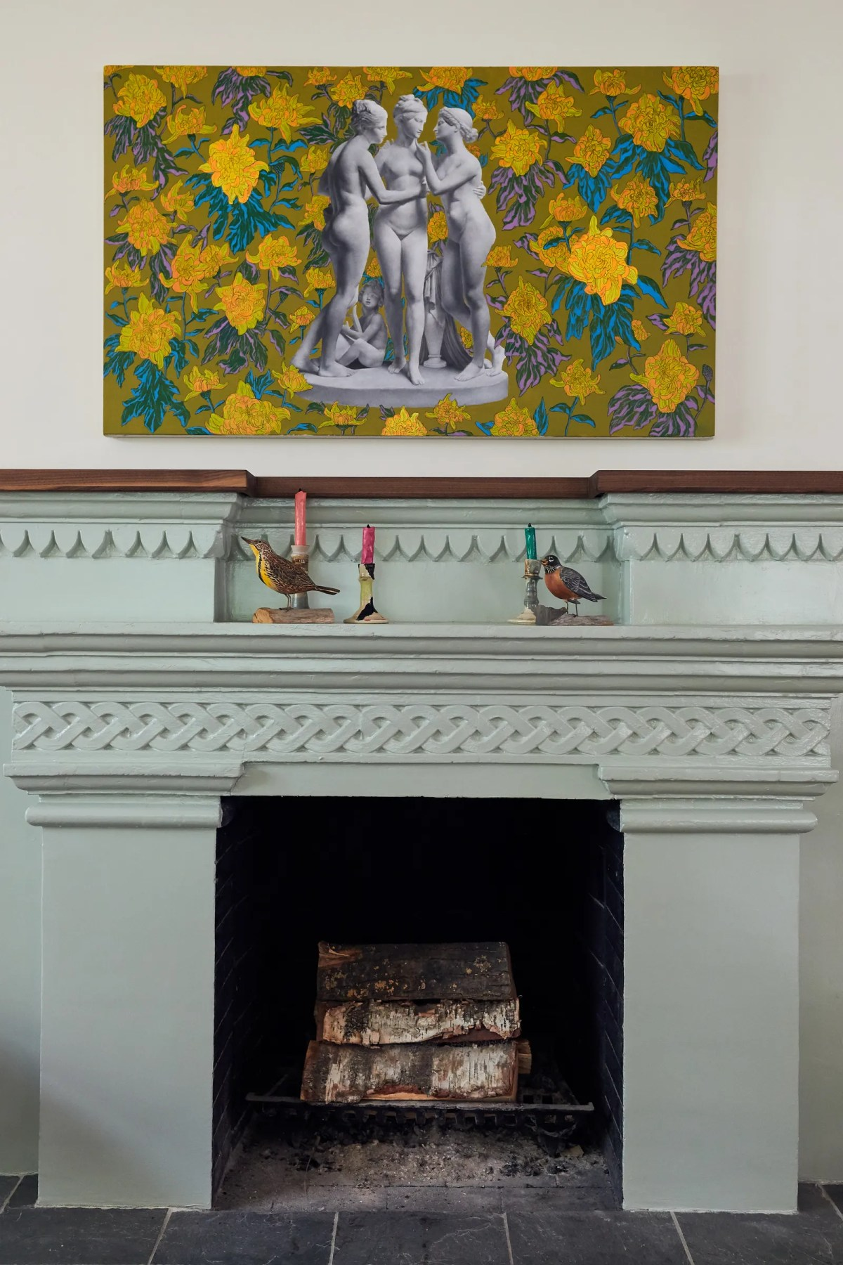 pThe fireplace repainted in a...