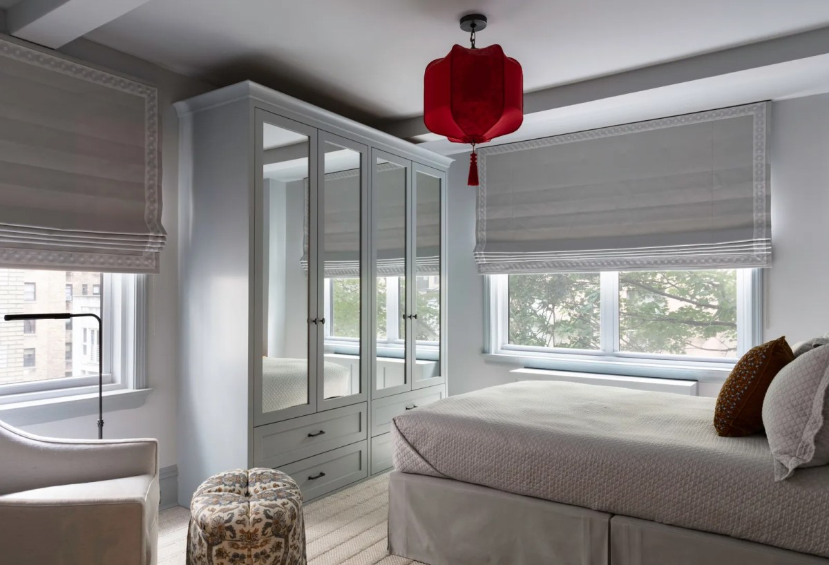 A serene bedroom with red lantern