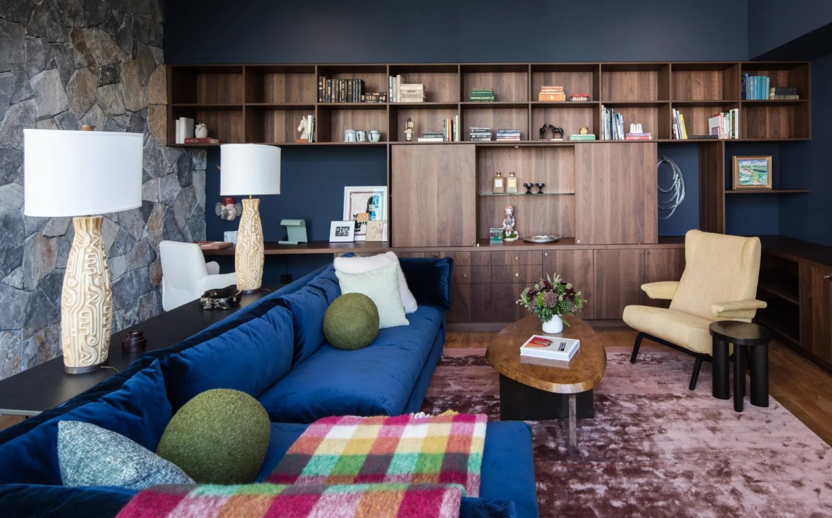 Living room with wood shelves and blue sofa