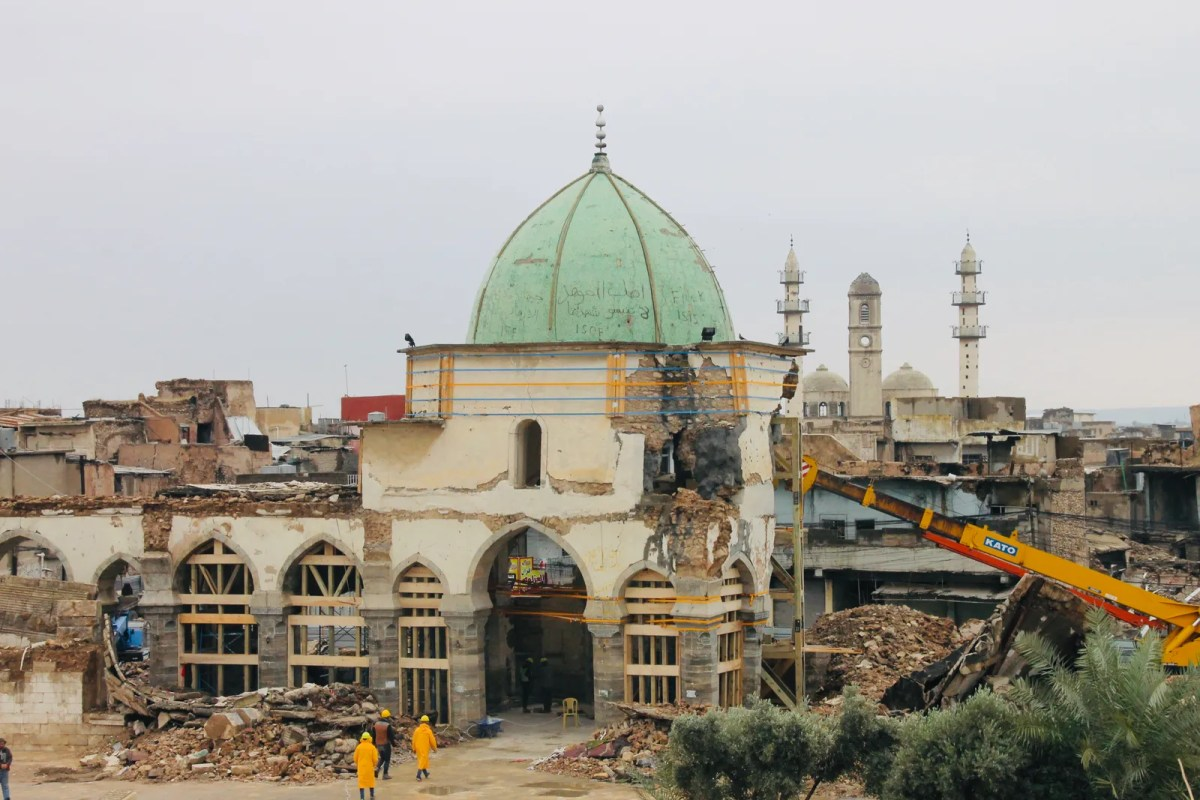 Image may contain Building Architecture Dome Human Person Mosque Steeple Spire and Tower