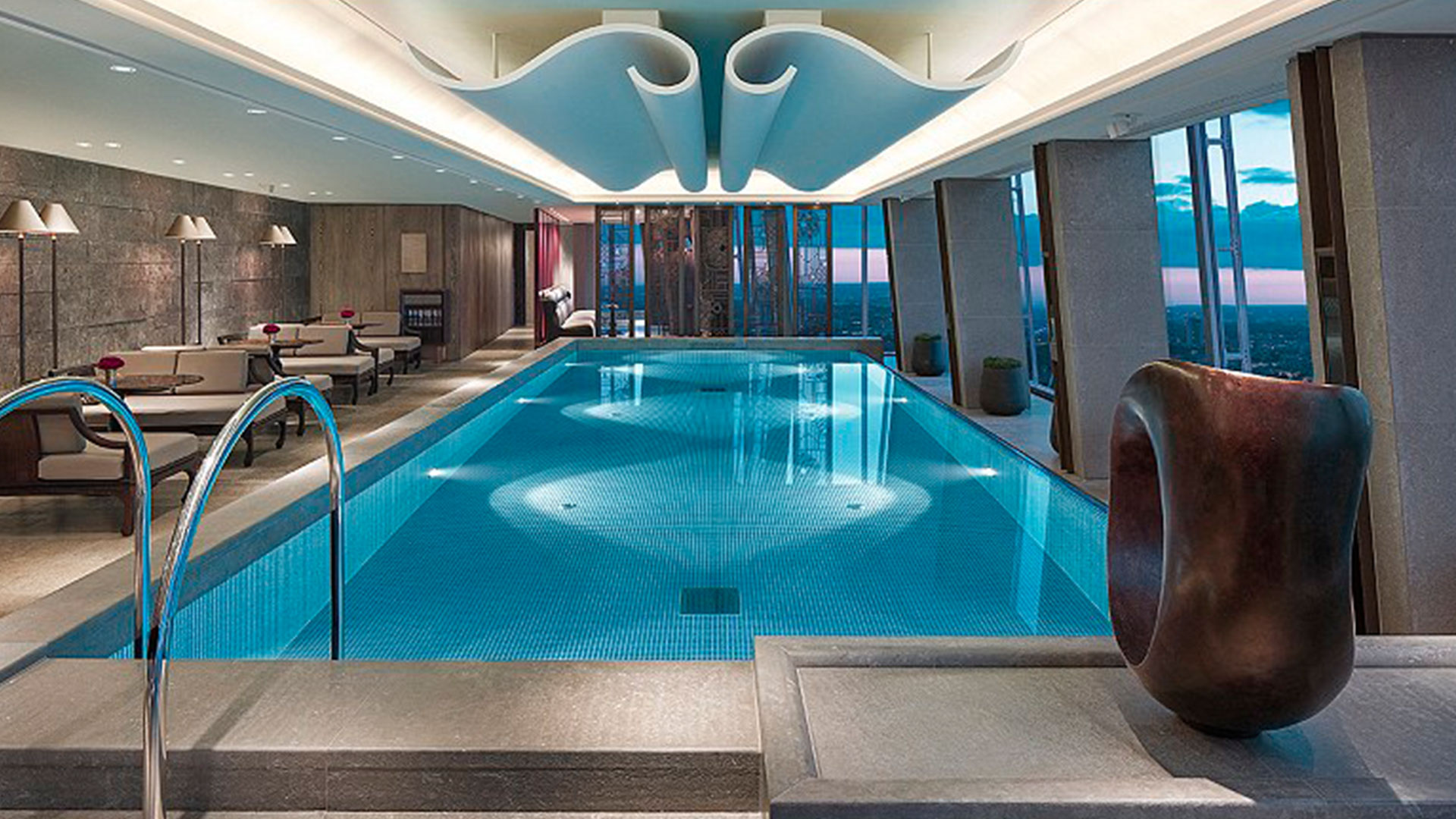 Dive Into These Stunning Hotel Swimming Pool Designs