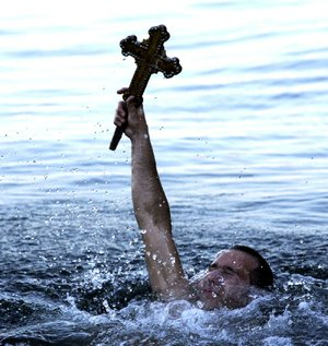 Orthodox Christians celebrate Theophany in various ways around the world. Some release doves as a symbol of the Holy Spirit while others toss crosses into water in remembrance of Christ's baptism. Young boys or men often dive into the water to retrieve the cross.