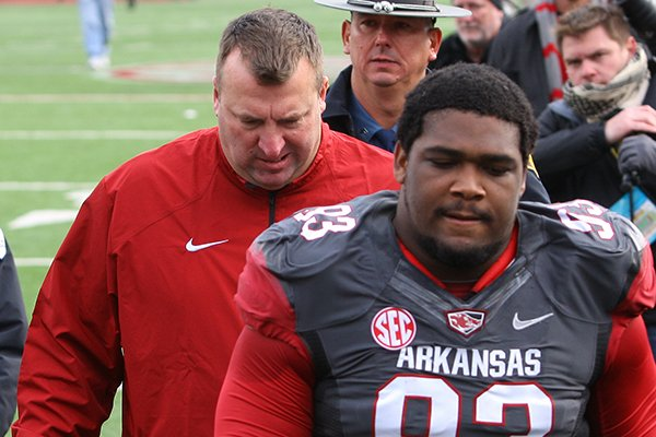 arkansas-coach-bret-bielema-and-his-team-leave-the-field-after-a-disappointing-overtime-loss-to-mississippi-during-their-game-saturday-at-war-memorial-stadium-in-little-rock