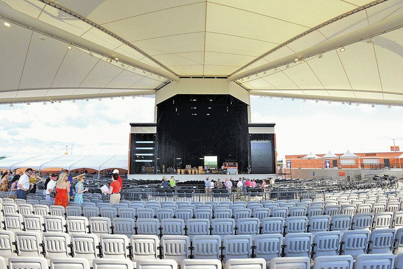 Staff photo samantha baker  nwasamantha officials give tours to donors and the media wednesday in rogers also walmart arkansas music pavilion readies for opening concert rh nwaonline