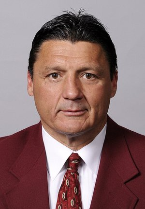 In a photo provided by the University of Southern California, date not known, Ed Orgeron poses for a photo. USC fired Lane Kiffin as football coach early Sunday morning, Sept. 29, 2013, ending the coach's tumultuous tenure a few hours after the Trojans lost 62-41 at Arizona State. Orgeron was picked as USC's interim head coach by athletic director Pat Haden, (AP Photo/University of Southern California)