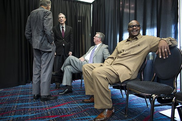 southwest-conference-hall-of-fame-inductees-wayne-martin-chuck-dicus-and-bill-burnett-talk-together-before-their-induction-ceremony-on-monday-nov-9-2015-at-the-statehouse-convention-center-in-little-rock