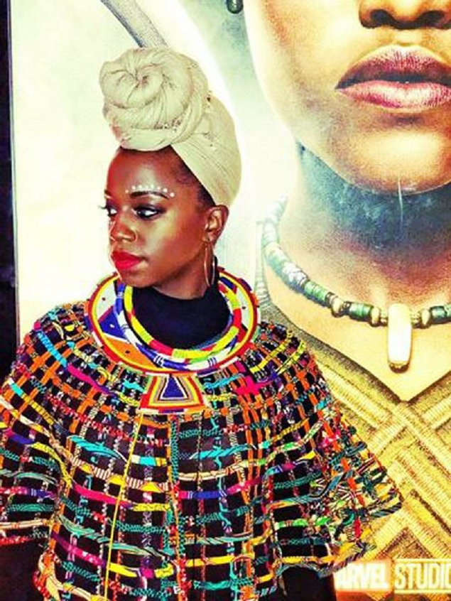 Shanetta Patterson of Little Rock shows off her Black Panther moviegoing ensemble, styled by Liberian-born designer Korto Momolu.Patterson was among many who, inspired by the movie and its fictional African country of Wakanda, wore African clothing or costumes to see Black Panther.