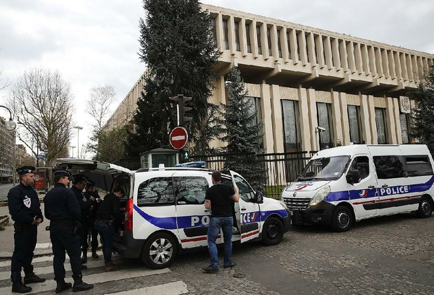 police-officers-some-in-riot-gear-stand-outside-the-russian-embassy-in-paris-on-monday