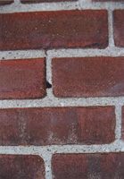 The color of the grains of sand makes a huge difference in mortar color once the actual cement paste wears away.