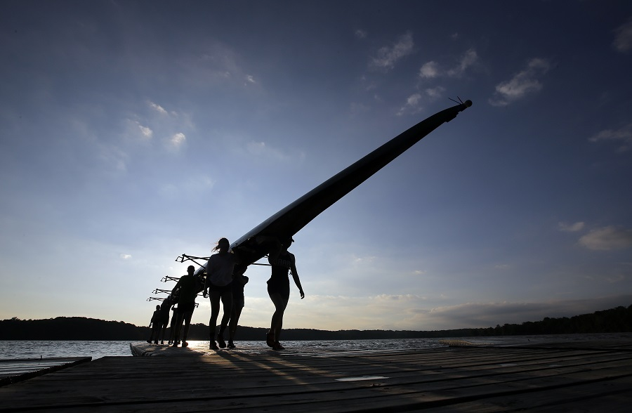 A team of rowers carry a rowing boat following a practice session at the Indianapolis Rowing Center at Eagle Creek Park Thursday, June 16, 2016, in Indianapolis. (AP Photo/Darron Cummings)