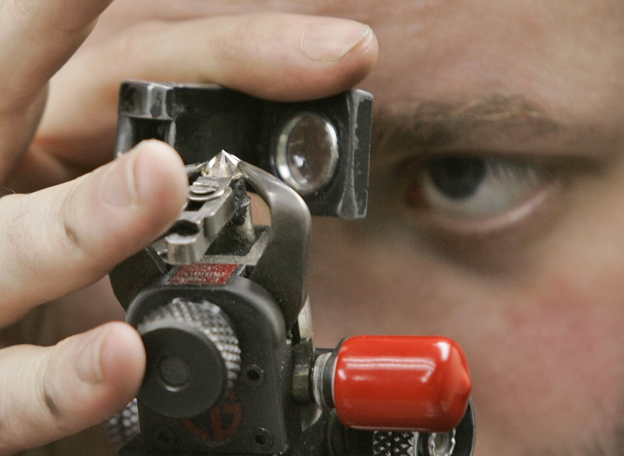 Image of man holding testing device near his eye. Photo: AP