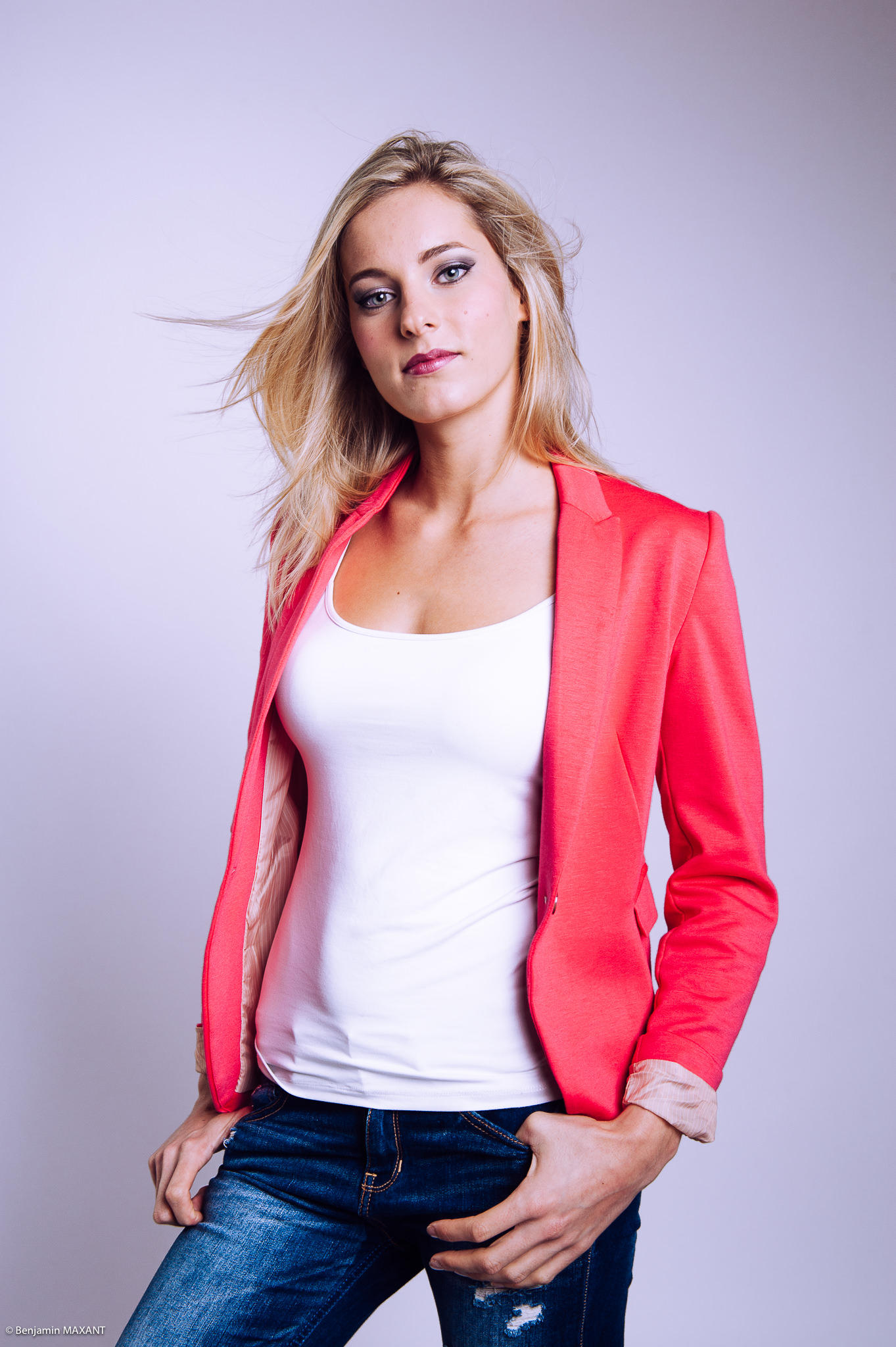 Casual photo shoot in studio jeans red blonde model jacket