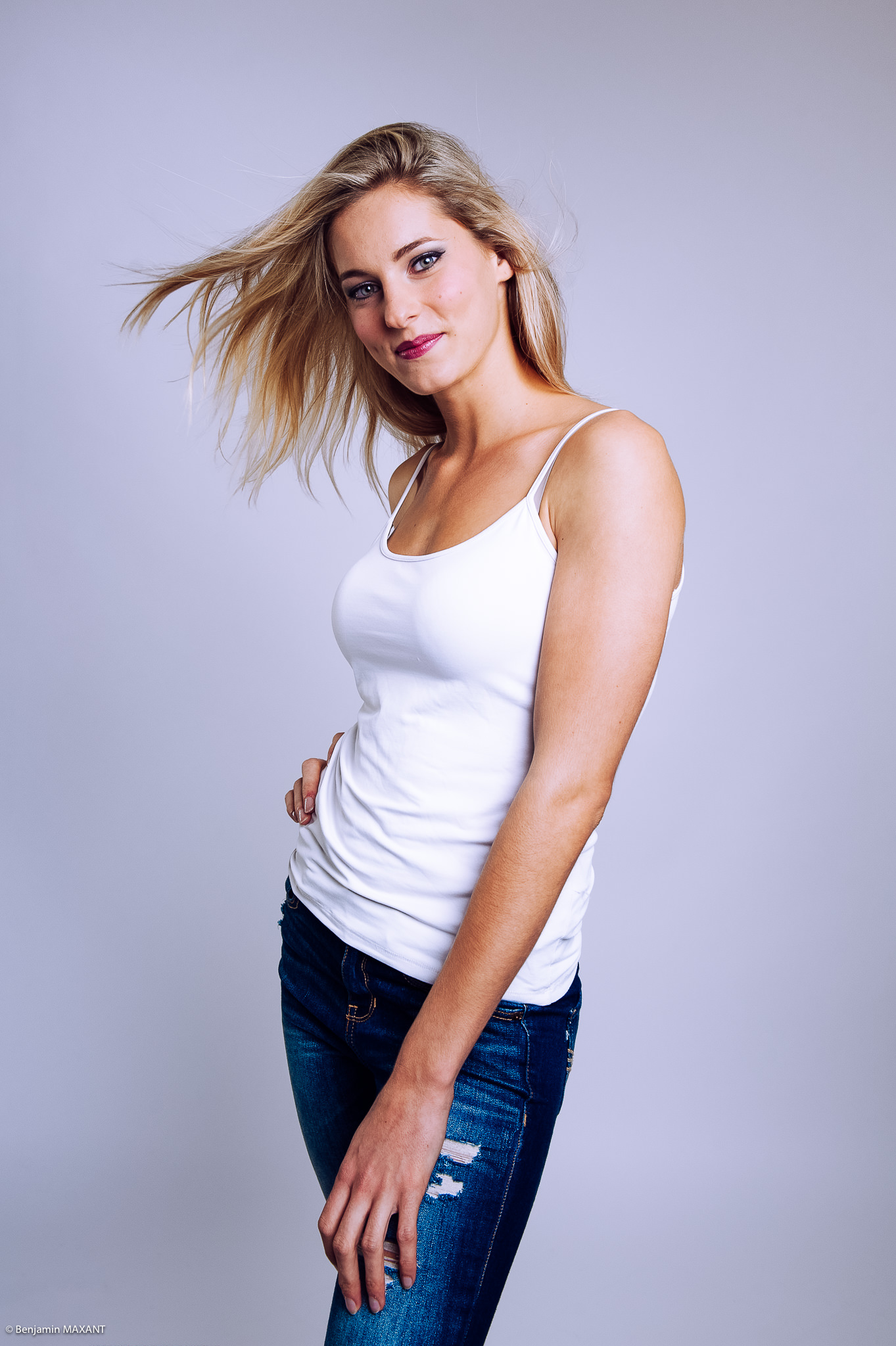 Casual photo shoot in studio jeans top white blonde model