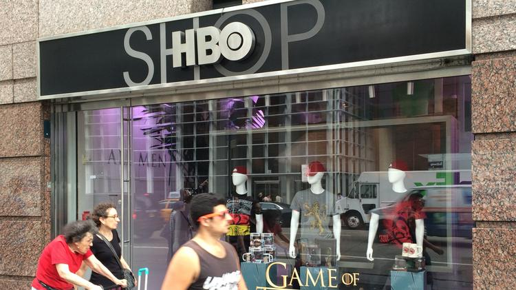 Pedestrians pass by the HBO retail store in the bottom floor of the premium channel's headquarters in midtown Manhattan.