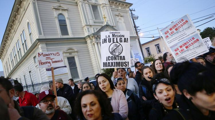 Demonstrators protest the proposals of Maximus Real Estate's development plan for 16th and Mission Streets outside the Laborers Local 261 Union Hall on 18th Street. (Conner Jay/San Francisco Business Times)
