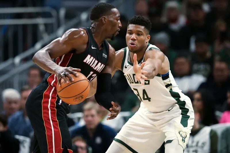 MILWAUKEE, WISCONSIN - OCTOBER 26:  Bam Adebayo #13 of the Miami Heat dribbles the ball while being guarded by Giannis Antetokounmpo #34 of the Milwaukee Bucks in the second quarter at the Fiserv Forum on October 26, 2019 in Milwaukee, Wisconsin. NOTE TO USER: User expressly acknowledges and agrees that, by downloading and/or using this photograph, user is consenting to the terms and conditions of the Getty Images License Agreement. (Photo by Dylan Buell/Getty Images)