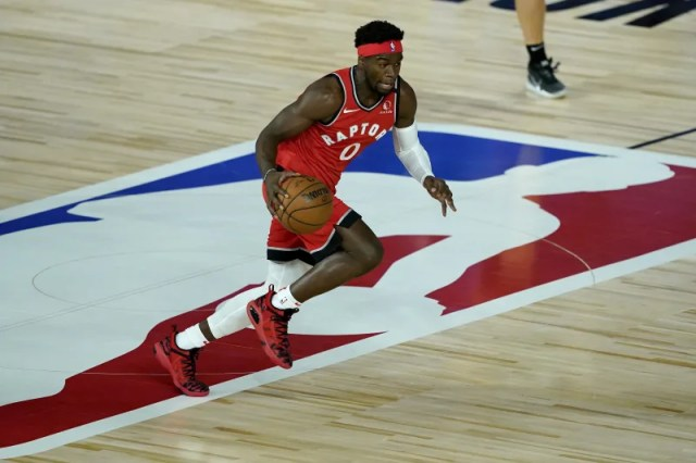 Toronto Raptors' Terence Davis (0) moves the ball up court against the Miami Heat during the first half of an NBA basketball game Monday, Aug. 3, 2020, in Lake Buena Vista, Fla. (AP Photo/Ashley Landis, Pool)