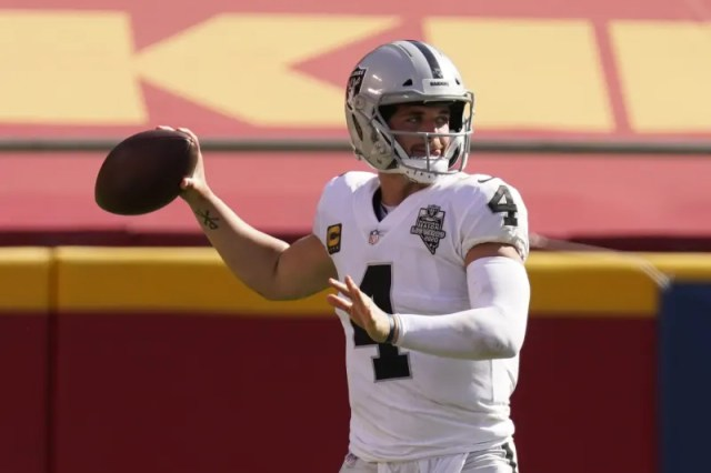 Las Vegas Raiders quarterback Derek Carr (4) looks to throw against the Kansas City Chiefs during the second half of an NFL football game, Sunday, Oct. 11, 2020, in Kansas City. (AP Photo/Charlie Riedel)