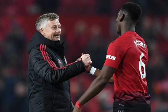 MANCHESTER, ENGLAND - DECEMBER 26:  Ole Gunnar Solskjaer, Interim Manager of Manchester United and Paul Pogba of Manchester United celebrate following their sides victory in the Premier League match between Manchester United and Huddersfield Town at Old Trafford on December 26, 2018 in Manchester, United Kingdom.  (Photo by Gareth Copley/Getty Images)