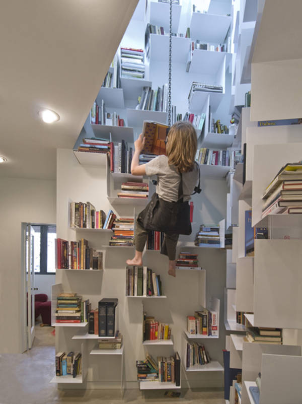 Bookcase in a stairwell that you access via bosuns chair Boing