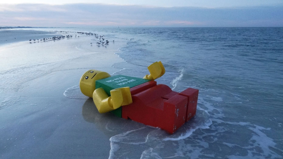 Image result for a giant lego man washed up on beach