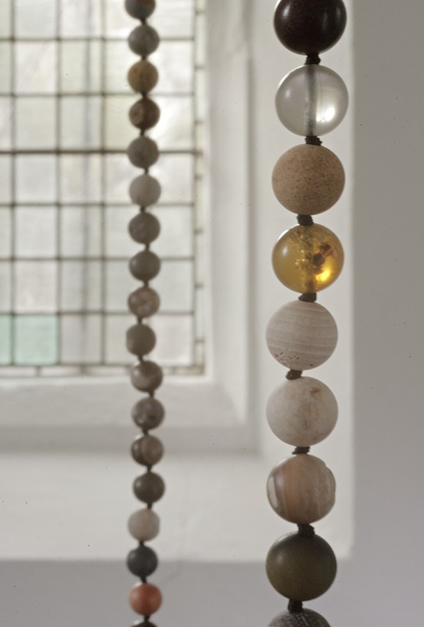 Fossil Necklace: chronologically ordered beads from the planet's history