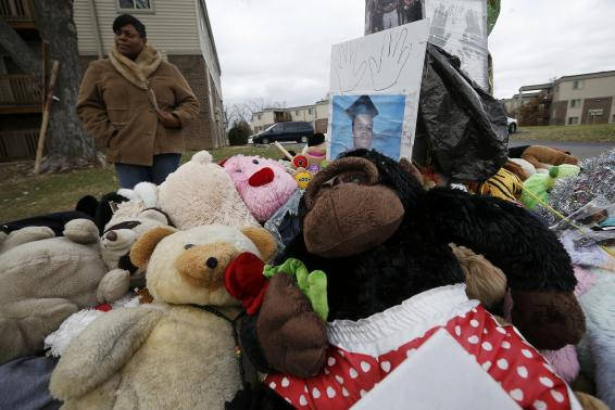 A woman looks at the memorial set up at the site of the shooting death of Michael Brown in Ferguson