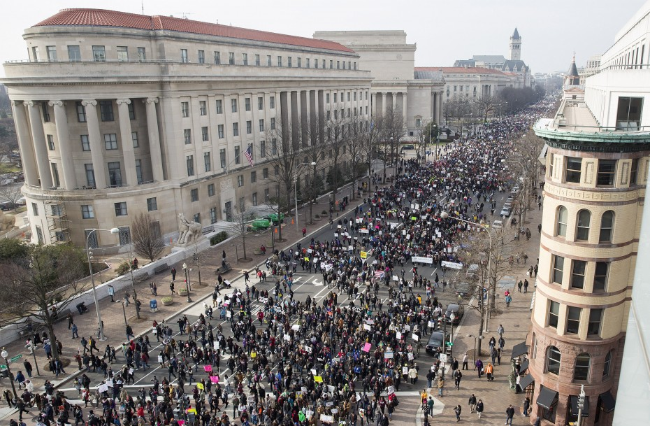 Demonstrators march down Pennsylvania Avenue during the National Action Network National March Against Police Violence in Washington December 13, 2014. REUTERS/Joshua Roberts