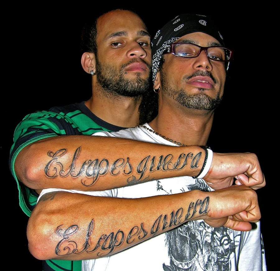 A 2008 photo by Melisa Riviere shows Bian Rodriguez, left, and Aldo Rodriguez, right, members of Los Aldeanos in Havana. Documents obtained by The Associated Press show that a U.S. agency infiltrated Cuba's hip-hop scene, recruiting unwitting rappers to spark a youth movement against the government.