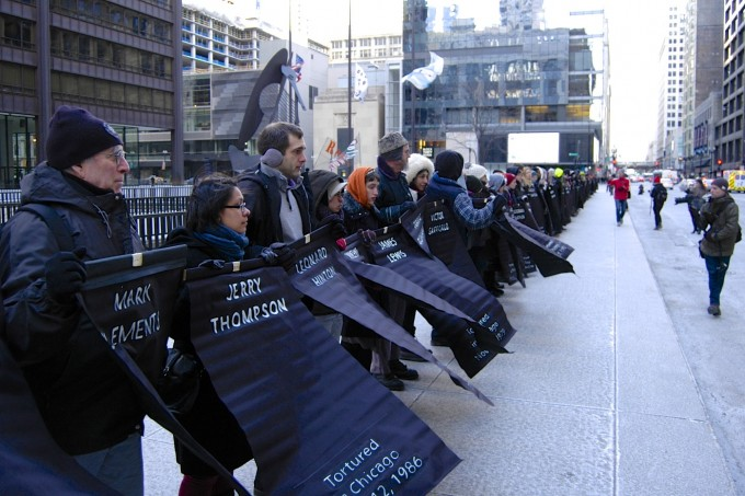 Flags bearing names of torture survivors [photo by Caroline Siede]