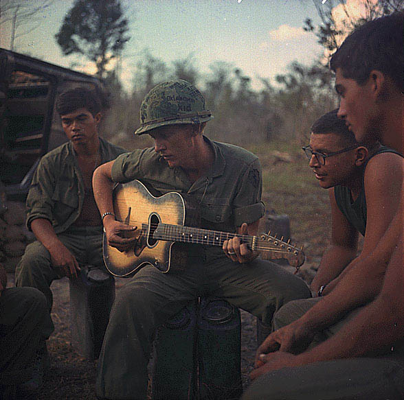 A U.S. soldier in Vietnam plays guitar during Operation Yellowstone, January 18, 1968. REUTERS/Courtesy U.S. National Archives
