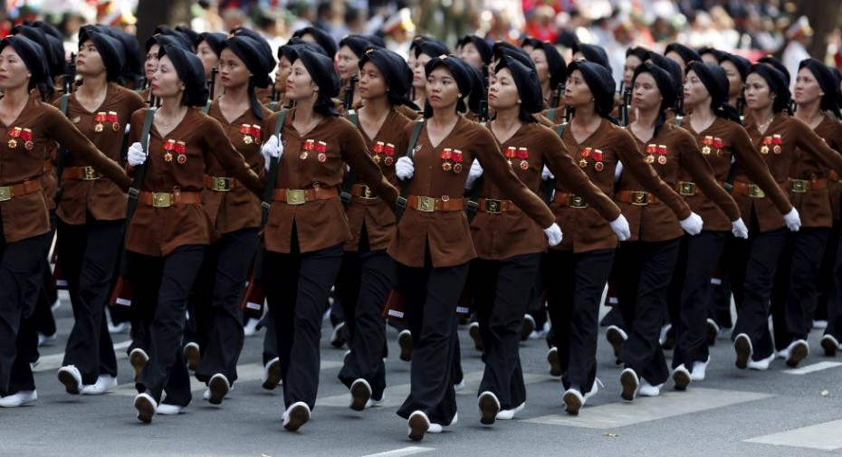 Female members of the Northern Guerilla Force march during a military parade as part of the 40th anniversary of the fall of Saigon in Ho Chi Minh City, April 30, 2015. REUTERS/Kham