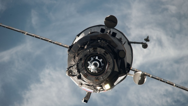 An unpiloted ISS Progress resupply vehicle approaches the International Space Station in February 2014. A similar space cargo ship that blasted off today is spinning and Mission Control is have trouble getting data from it. (NASA)