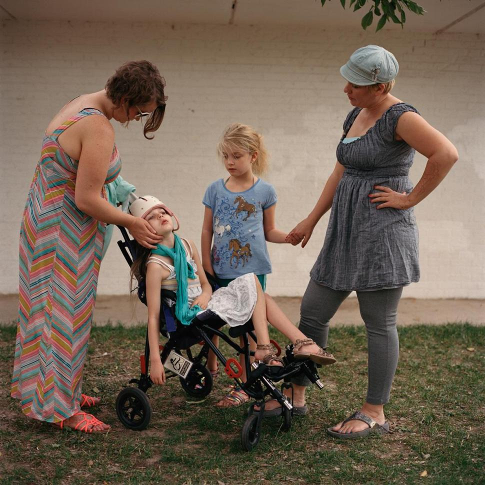 Holli Brown comforts her daughter, Sydni Yunek, who is having a seizure at a medical marijuana support group picnic in Colorado, while Sara Lightle and her daughter, Madeline, stand by. Both mothers moved to the state, where recreational and medical marijuana are legal, to have access to cannabidiol (CBD), a non-psychoactive drug extracted from marijuana that can reduce or prevent seizures in some children. PHOTO: LYNN JOHNSON, NATIONAL GEOGRAPHIC