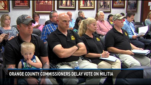Smith and militia members, screengrab from 12newsnow Texas.