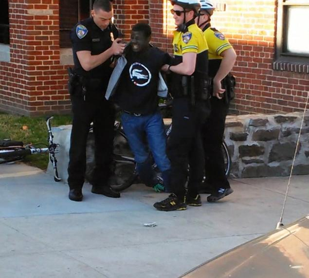 A still from video recorded by Kevin Moore of Freddie Gray's arrest on April 12, which shows the 25-year-old screaming in pain. Gray, 25, later died in police custody.