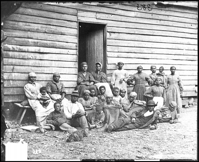 """""""Group of Contrabands at Foller's House, 1862,"""" Library of Congress via"""